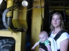 Elaine Hoffmeister Mooney and her son Dominick with their 1977 Selma Harvester