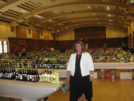 Jeanette Merritt of Purdue University in front of 5,000 bottles of wine awaiting tasting.