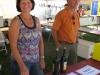Mickie Ryan and her husband Kyle spend their Saturday working at the Fee Run Cellars booth at the New Buffalo Harvest and Wine Fest
