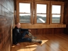 Gene Sigel sits on the red oak floor of what will become the tasting room for his Red Eagle Distillery in Harpersfield Township, Northeast Ohio. Sigel renovated an 1885 barn to house his distillery and tasting room, which is located on a farm next to his vineyard.