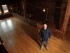 Gene Sigel stands in the 1885 barn that he restored to serve as a micro-distillery and tasting room.