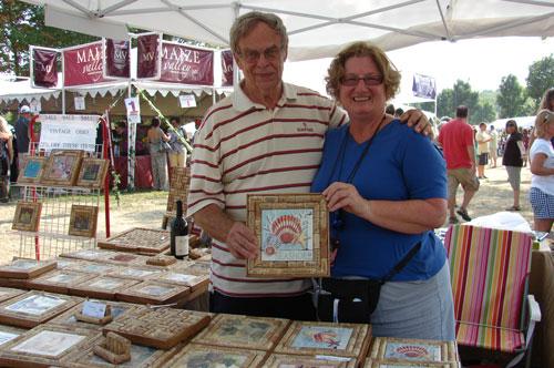 Herm Waltemate and Nancy Ernestes display their cork art