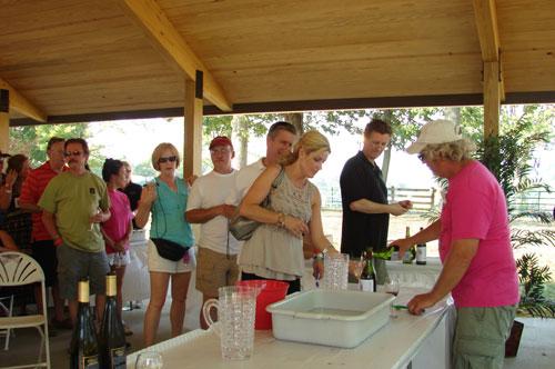 Lee Klingshirn of Klingshirn Winery pours a taste