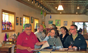 David Danzinger discussing wine with customers at his winery in Alma,  Wisconsin.