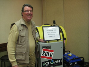 "Ernie Wilmink, president of Agriozein with one of  his ""ozonators"""