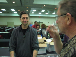 Gilbert Hermes from White Wind Farm smiles as Michael Jones from Scott Labs tries his wine