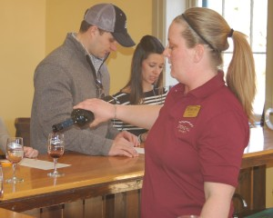 A Stone Hill Winery employee pours wine during a tasting that came with a $2.50 wine cellar tour.