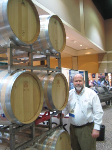 Dan Brick of Michigan based Brick Packaging,  shows off his oak barrels.
