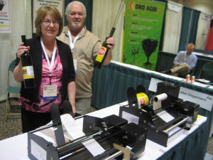 Rocky Mount, Missouri's JoAnn Brooks and partner show off their Dispensa-Matic Label Dispensers.