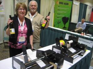 Rocky Mount, Missouri's JoAnn Brooks and partner show off their Dispensa-Matic Label Dispensers.