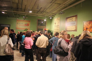 Crowd sampling a wide variety of wine, including St. James Winery who showcased their sweet wines.
