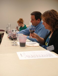 (From left): Jessica Pearcy from St. James Winery and James and Charla Fashing of Cedar Lane Vineyard blindly sample wine on Tuesday, March 26.