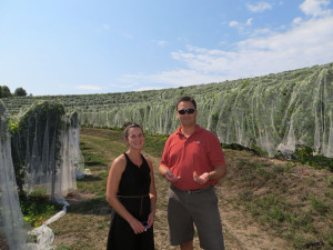 Coryn Briggs, Director of Marketing, and Lee Lutes of Blackstar Farns.  Extensive bird netting is a necessity at Black Star where grapes can ripen into October.