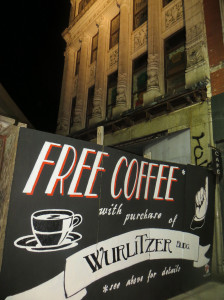 """The sign above reads, """"Free Coffee with Purchase of Wurlitzer Building."""""""