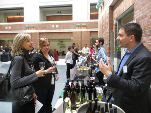Sharon Meyers of Meyers Communication (left) and Jennifer Horkman of Uncommon Ground, both from Chicago, speak with Stever Wroblewski of Fenn Valley Winery.  Fenn Valley will be selling its Sauvignon Blanc outside its tasting room for the first time this year.