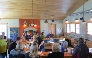 Boathouse Vineyards in Lake Leelanau, Michigan designed a circular tasing room bar with extra space for employees to service multiple customers.