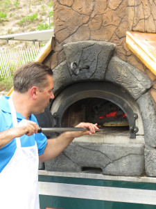 Vince of Classic Catering in Bridgeman pulls a pizza from a portable over
