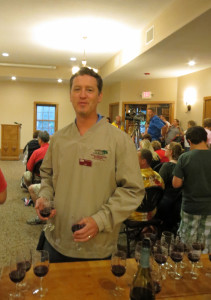 Colin  of Wollerhsheim Winery.  Each guest at the wine cave ribbon cutting received a free taste of estate grown Domaine Du Sac with which to make a toast.