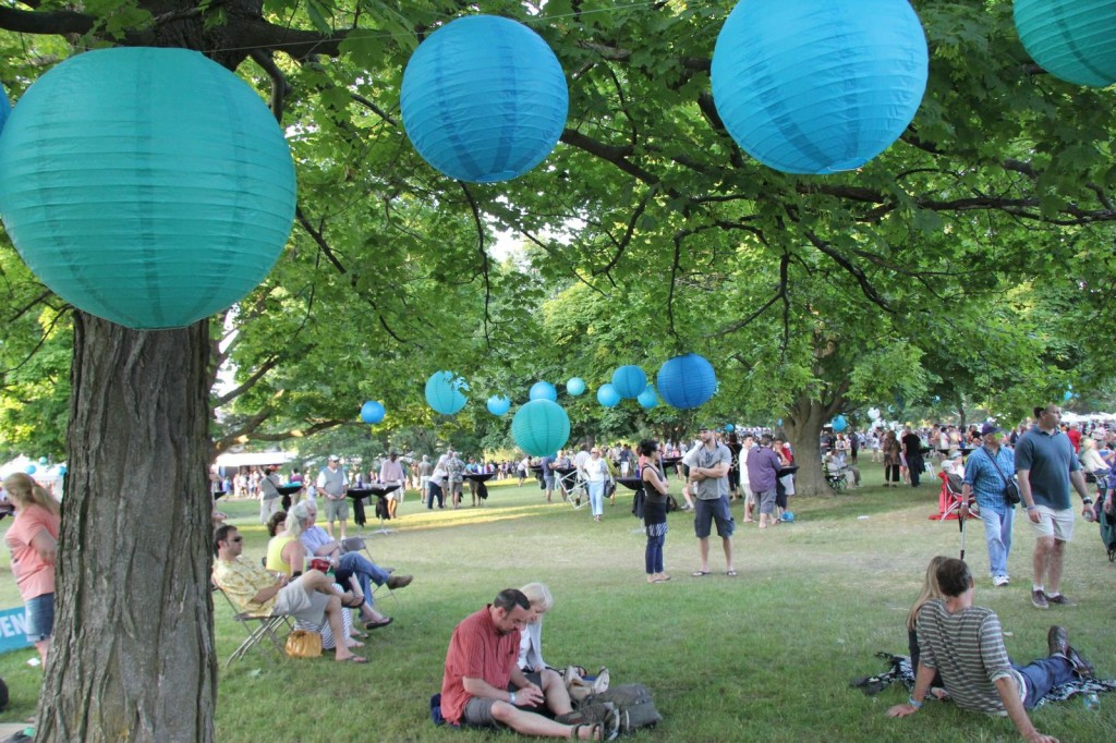 Hundreds of blue globes hung from trees lent an under-the-tent feel to the grounds of the Village at Grand Traverse Grounds as a sell-out crowd of some 5,000 people settled in to listen to musical acts that included Sixto Rodriguez of 'Finding Sugar Man