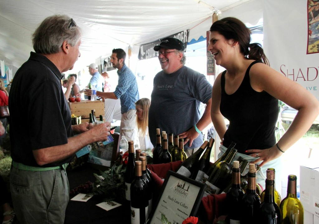 Despite the record crowd, festival-goers had plenty of chances to chat with wine pourers and experienced winemakers like Adam Satchwell, pictured here at the Shady Lane Cellars booth.