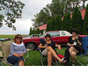 Vicki Jack, Kathy Sommer, and Julie Walker enjoying Botham wines at the Vintage Car show.
