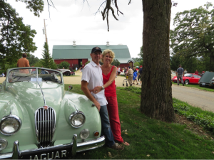 Peter and Sarah Botham leaning against her late Father's Jaguar