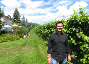 Bys Estate operations manager Patrick Brys on the east side of the winery where the expanded deck will be built in 2014.