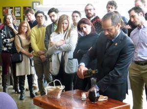 Master Sommelier Serafin Avlarado demonstrates decanting by candlelight.