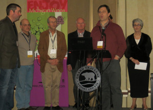 2013 Michigan Competition Gold Medal winners: John Kroupa, Peninsula Cellars; Dave Miller, White Pine Winery, Dan Matthies, Chateau Fontaine; Joe Herman, Karma Vista; Lee Lutes, Black Star Farms.  (Not pictured, Coenraad Stassen, Brys Estate.) Linda Jones of the Michigan Grape and WIne Industry Council, far right.