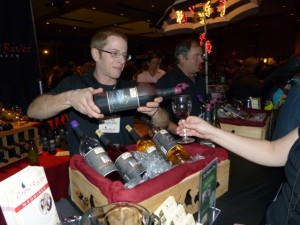 Lucas Gilhousen, winemaker for Crow River Winery located in Hutchinson, Minnesota, pours a sample of South Fork.  Gilhousen explains Crow River's American red wine with a blend of 60% Frontenac, 20% Marquette, and 20% Red Zinfandel.