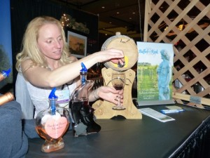 Dressed as goddesses, Nicole Dietman, owner and winemaker of Buffalo Rock Winery sampling her wineries two ports.  Broken Heart Mender (2012 Frontenac Gris, left) fortified wine.