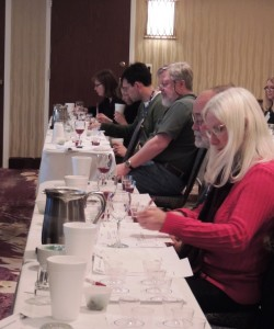 Members of the Iowa wine industry at the annual Iowa Wine Growers Association meeting in March 2013 participate in a tasting and evaluation of Marquette wines treated with enological tannins.