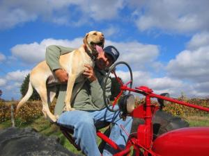 Hickory Creek Winery's Labrador, Kia with owner, Eric  Wagner (courtesy winery)