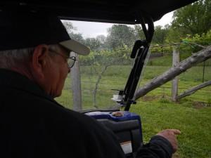 Terry Neuner points to his vines
