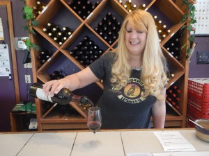 Mindy pours a Norton in Augusta Winery's shop and tasting room