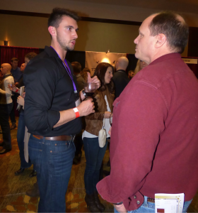 Steven Boyd Vineyard and Winery Manager at Parley Lake Winey discusses winemaking techniques with a Winter Wine Fest patron.