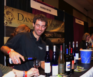 Luke Sombke wine maker for Danzinger Vineyards from Alma, Wisconsin pours a sample of their Twilight Delight (Marquette and Saint Croix grapes).