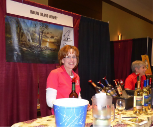 "Cindy Glam and Julie Miller sample Indian Island wines featuring a wine entitled, ""Midnight Fantasy"" (Frontenac infused with chocolate)"