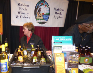 Joan Northhouse and Herdie Baisden(Co-Owner with wife not pictured, Carol Wiersma) sample their wines and ciders from Maiden Rock Winery and Cidery.