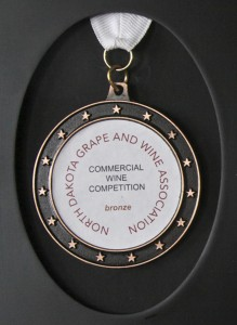 Judges at the 2015 Wine Competition of the North Dakota Grape Growers and Winemakers Association conferred a bronze on Randy Albrecht's Aronia Berry Wine from Wolf Creek Winery in Coal Harbor